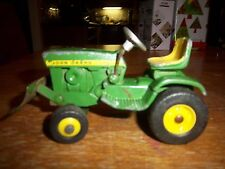 John Deere 140 lawn mower tractor with silver steering wheel and front blade