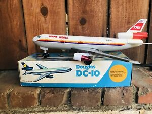 Douglas DC-10 Vintage Battery operated Tin and plastic toy Stop Go Boxed  Mesem