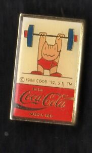 BARCELONA 1992 OLYMPIC GAMES. SPONSOR PIN. COCA COLA. MASCOT WEIGHTLIFTING