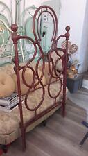 antico letto singolo in ferro battuto rosso vinaccia,con sponde.'900