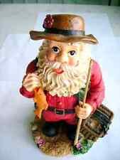 "A beautiful Figurine of Santa holding a Fishing Pole 9""tall 5""wide5""deep Painted"