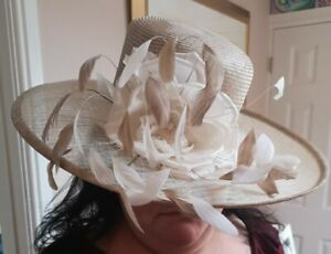 Stunning cream ladies wedding hat with feathers and large flower