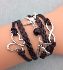 Bracelet noir couple d'oiseaux avec perle noire, papillon et lien infini.