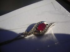 10Kt White Gold Ruby and Diamond accent pendant with gold chain