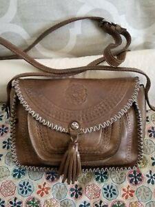 distressed brown leather satchel raw edge leather bag with steampunk pirate skeleton key