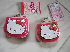 2x Hello Kitty Zip Clip Metallbox mit Anhänger Geldbörse Schleife/Erdbeere