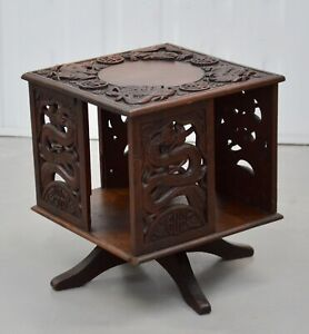 AN EARLY 20th CENTURY CHINESE CARVED REVOLVING TABLE TOP BOOKCASE