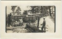 Loggers Work at Sawmill in Pine Woods w/ Sawdust Pile Real Photo Postcard