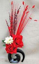 ARTIFICIAL SILK 2 RED ROSE/CREAM DRAGON WITH GRASS IN BLACK CERAMIC FOSSIL VASE