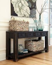 Signature Design by Ashley Gavelston Sofa Table Black 4 drawers open shelf