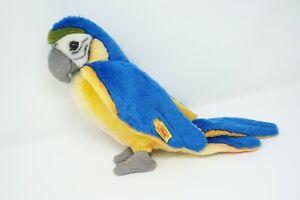 Steiff Papagei Lori blau/gelb mit Knopf und Fahne 063879; 26 cm