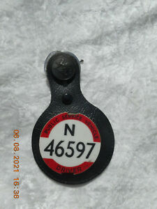 LONDON TRANSPORT  PUBLIC SERVICE VEHICLE DRIVER BADGE   N 46597  WITH HOLDER