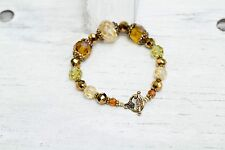 Women's Handmade, Round, Green, Brown, and Yellow Beaded Bracelet,