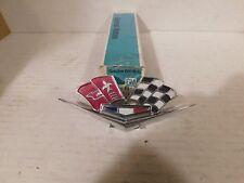 3872930  62 63 64 65 66 Corvette NOS Cross-Flags Emblem