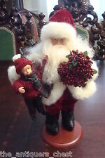 Tina Mitchelll retired Santa, with a large doll and a wreath, ceramic[a4sant*]