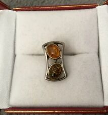 AMBER IN SILVER PENDANT - TWO AMBER STONES IN DIFFERENT SHADES CASED IN SILVER