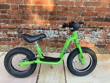 Puky balance bike in green, with stand and brake. Good condition