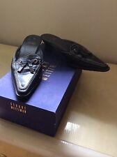 Stuart Weitzman women's shoes FLIPPANT slides mules low heels black leather Sz 6