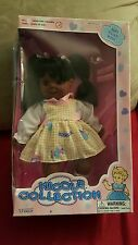 Uneeda NICOLE COLLECTION  1996 African American Doll/Googly Eyes/comb/curlers
