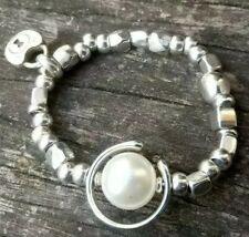 Pulsera con perla,  elastica, 50 corazones de zamak, compra uno para ti!