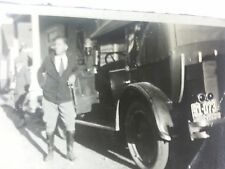 Vintage African American photo of handsome man and fine car