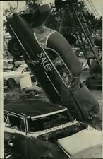 1966 Press Photo A car lifted by a crane in New Orleans for a Christmas clean-up
