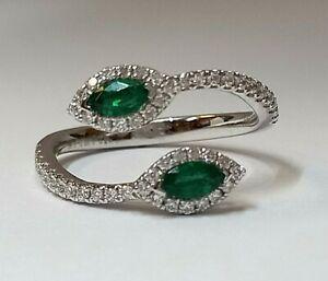An elegant DESIGN  Emerald & Diamond Ring set on 18k wg