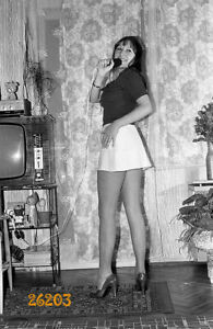 amateur singer smiling in mini skirt, stiletto shoes, legs, 1970s orig. negative