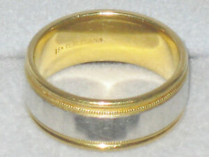 18 KT. GOLD AND PLATINUM WEDDING BAND 11.5 gr.