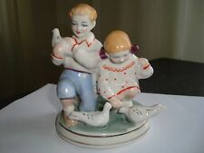 USSR Soviet Ukrainian ZHK Polonne Porcelain Figurine Children and pigeons