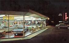 Photo. 1962-3. Hinsdale, Illinois.  Jack Loftus Ford auto dealership