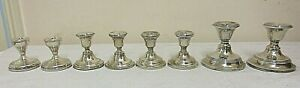 ANTIQUE SOLID SILVER COLLECTION OF TRAVELING MINIATURE CANDLESTICKS 1220  GRAMS