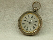 Antique Silver watch with original key.