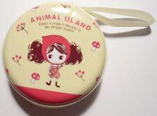 Animal Island porte monnaie rond métal jaune pâle motif petite fille