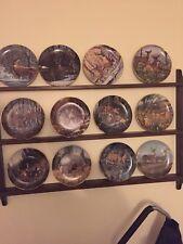 12 Danbury Mint Plates with Display Rack