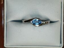 14 kt white gold oval blue topaz ring with diamond accents 142039