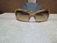 Miu Miu Lady's Beige Sunglasses with plastic gray case