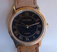 Tutima Woman´s Watch, black dial and gold / Reloj marca Tutima para mujer