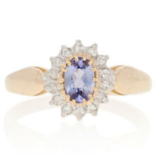 .63ctw Oval Cut Tanzanite & Diamond Ring - 14k Yellow Gold Halo