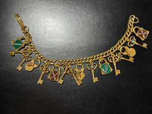 VINTAGE GOLDETTE CHARM BRACELET WITH A LOCK and SKELETON KEY THEME. 16 CHARMS