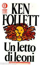 LIBRO=UN LETTO DI LEONI=KEN FOLLETT=OSCAR MONDADORI=RISTAMPA 2004