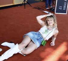 MILEY CYRUS - LYING ON HER SIDE WITH A SKIRT ON !!!