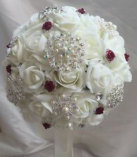 Wedding flowers Ivory roses, brooches and diamante red rose embellishments