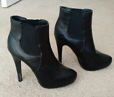 Black Fashion Booties, Sleek and Chic-- Women's size 7.5