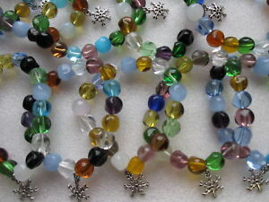 Wholesale 10 Glass Bead Bracelets with Frozen Snowflake Charm.  Disney Inspired