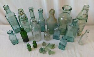 Selection of Vintage Glass Bottles Some with Markings Ink Milk Medicine Spirits