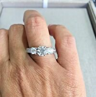 3 Stone Diamond Ring with Pave set diamonds on all 4 sides