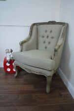 French Style Wing Back Armchair In A Weathered Oak Finish