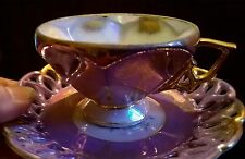 iridescent purple tea cup and saucer with lots of gold accents