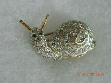 Carolee Vintage Snail Pin Pave Crystals Green Eyes Gold Tone